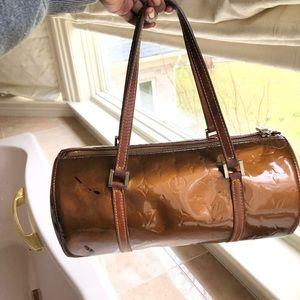 Louis Vuitton brown bag.